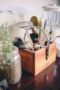 Collection of cooking utensils on a wooden kitchen counter